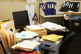 storing veterinary files all in one place messy desk