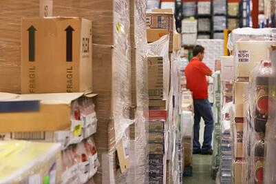 veterinary practice inventory control man in warehouse
